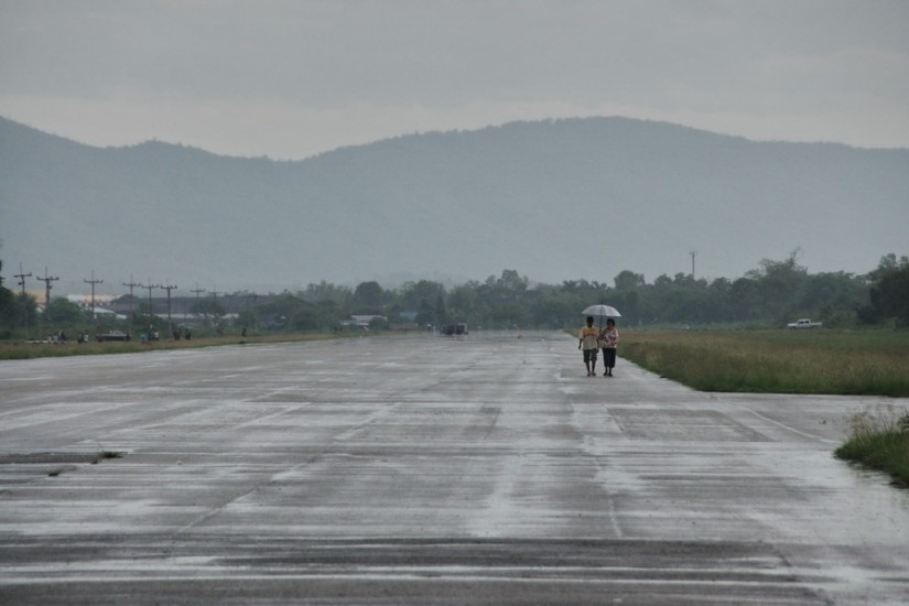 Chiang Rai people walk old runway airport